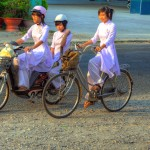 Chau Doc school girl on eletricity-bike